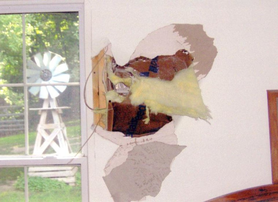Photo -  A 105 mm howitzer projectile traveled nearly two miles and blasted through a wall at the home of Gene and Jeanne Kelley, leaving a 15-inch hole in their master bedroom. Photo courtesy of the Miami News-Record    -