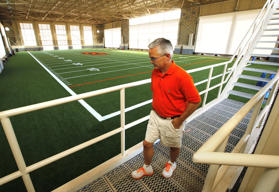 Photo - Kevin Klintworth, Senior Assistant Athletic Director, walks along the catwalk as Oklahoma State University (OSU) unveils its new Sherman E. Smith Training Center indoor football practice facility on Friday, July 12, 2013 in Stillwater, Okla.  Photo by Steve Sisney, The Oklahoman