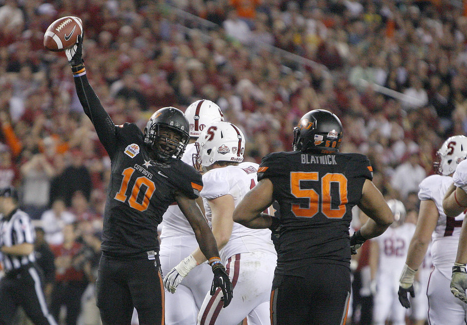 Oklahoma State's Markelle Martin (10) celebrates a fumble recovery with Jamie Blatnick (50) during the Fiesta Bowl between the Oklahoma State University Cowboys (OSU) and the Stanford Cardinal at the University of Phoenix Stadium in Glendale, Ariz., Monday, Jan. 2, 2012. Photo by Sarah Phipps, The Oklahoman