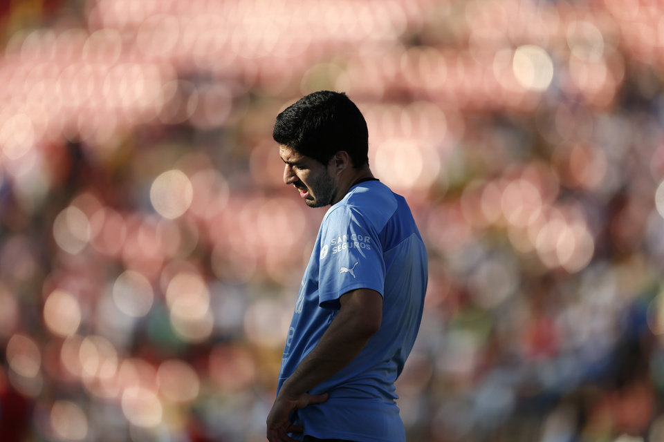 Photo - Uruguay's Luis Suarez is seen during a training session at Jacare Stadium in Sete Lagoas, Brazil,  Tuesday, June 10, 2014. Uruguay continues its preparations for the upcoming 2014 World Cup. (AP Photo/Victor R. Caivano)