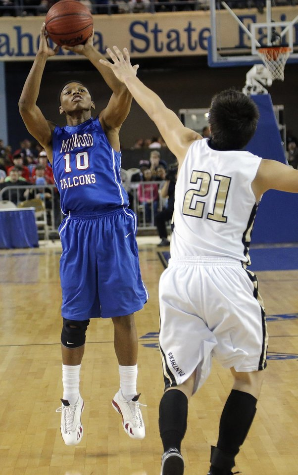Photo - Millwood's Chris Crook (10) shoots over Okemah's Dion Scott (21) during the state high school basketball tournament Class 3A boys championship game between Millwood High School and Okemah High School at the State Fair Arena on Saturday, March 9, 2013, in Oklahoma City, Okla. Photo by Chris Landsberger, The Oklahoman