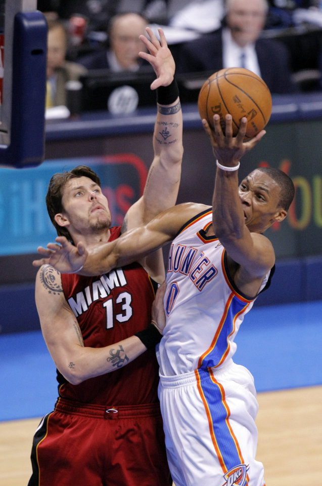 Oklahoma City's Russell Westbrook (0) shoots a lay up as Miami's Mike Miller (13) defends during Game 1 of the NBA Finals between the Oklahoma City Thunder and the Miami Heat at Chesapeake Energy Arena in Oklahoma City, Tuesday, June 12, 2012. Photo by Sarah Phipps, The Oklahoman