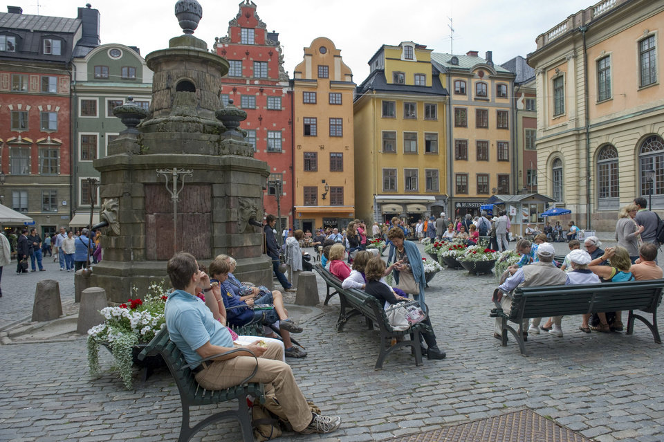 Photo - This is a July 26, 2011 file photo of tourists in  Stortorget Square in the Old Town of Stockholm. Buildings from the 17th century stand askew, worn by time but meticulously repaired and repainted in soft shades of yellow and rose. Unless you're looking for a plastic Viking helmet, turn off the main street and its gift shops and discover a plethora of small boutiques, art galleries and fashionable cafes.  (AP Photo/Leif R Jansson, File) SWEDEN OUT