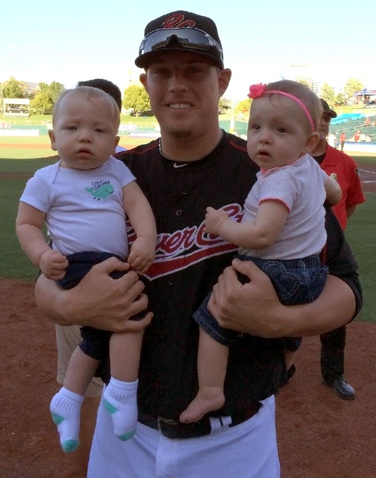 Jeremy McBryde, of Midwest City, holds his two children, Kamden and Hadley. McBryde is a pitcher for the Oakland Athletics' Triple-A affiliate. <cutline_credit_leadin>Photo Provided</cutline_credit_leadin> <strong>Provided</strong>