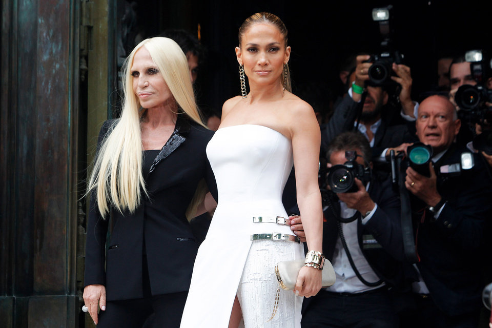 Photo - Singer Jennifer Lopez, right, and Italian fashion designer Donatella Versace, pose for photographers prior to the Atelier Versace Fall Winter 2014-15  Haute Couture fashion collection, presented in Paris, Sunday, July 6, 2014. (AP Photo/Thibault Camus)