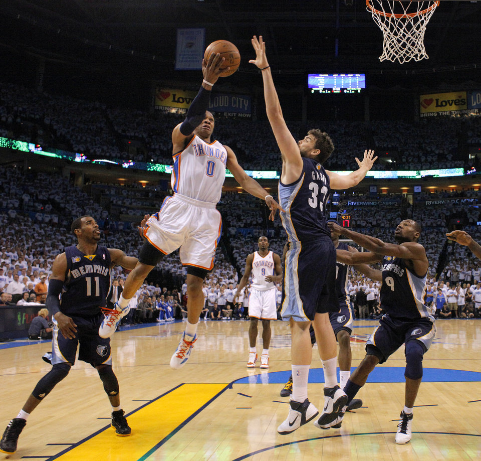Oklahoma City's Oklahoma City's Russell Westbrook (0) goes to the basket between Mike Conley (11), Marc Gasol (33), and Tony Allen (9) of Memphis during game five of the Western Conference semifinals between the Memphis Grizzlies and the Oklahoma City Thunder in the NBA basketball playoffs at Oklahoma City Arena in Oklahoma City, Wednesday, May 11, 2011. Photo by Bryan Terry, The Oklahoman