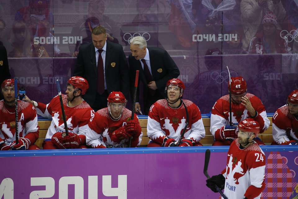 Photo - Russian head coach Zinetula Bilyaletdinov talks to players on the bench in the third period of a men's quarterfinal ice hockey game against Finland at the 2014 Winter Olympics, Wednesday, Feb. 19, 2014, in Sochi, Russia. (AP Photo/Mark Humphrey)