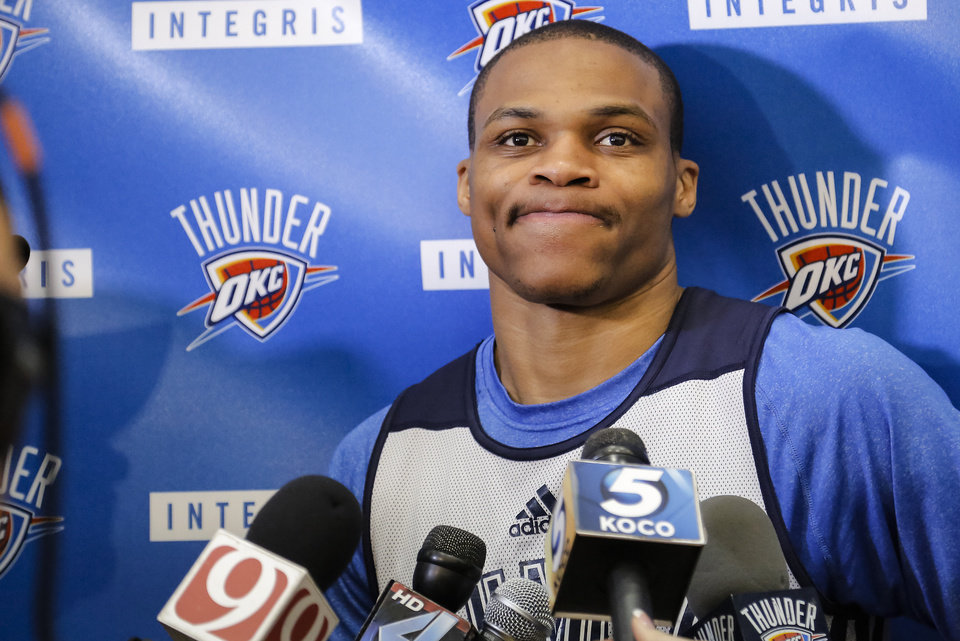 Photo - Russell Westbrook responds to questions during the Oklahoma City Thunder media availability at the Thunder practice facility in Oklahoma City, Okla. on Monday, May 12, 2014.   Photo by Chris Landsberger, The Oklahoman