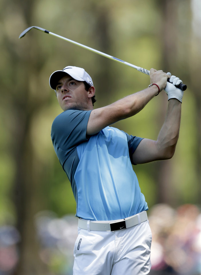 Photo - Rory McIlroy, of Ireland, watches his approach shot on the first hole during the final round of the Wells Fargo Championship golf tournament in Charlotte, N.C., Sunday, May 4, 2014. (AP Photo/Chuck Burton)