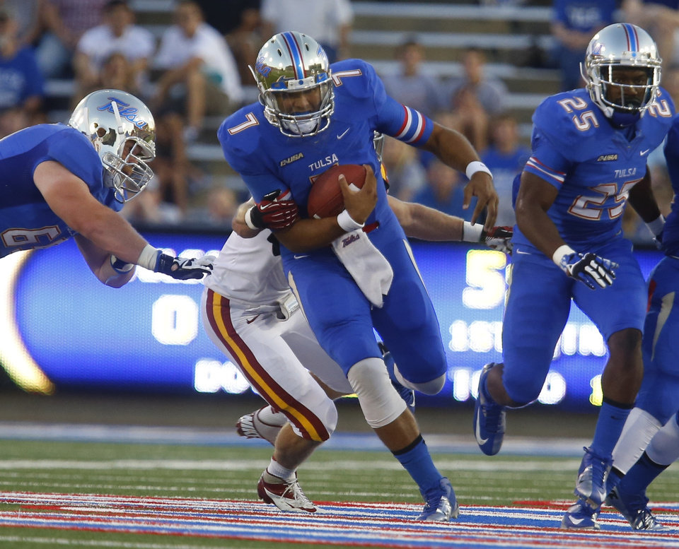 Photo - Tulsa's Cody green scrambles during the first half of an NCAA college football game, Thursday, Sept. 26, 2013 in Tulsa, Okla. (AP Photo/Tulsa World, Tom Gilbert)  ONLINE OUT; TV OUT; TULSA OUT