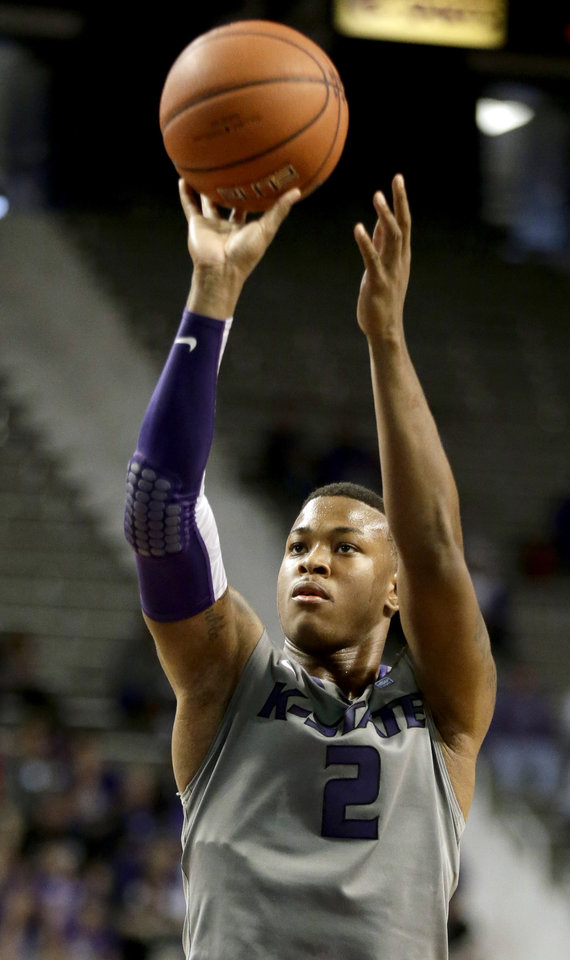 Photo - Kansas State's Marcus Foster puts up a shot during the second half of an NCAA college basketball game against Long Beach State Sunday, Nov. 17, 2013, in Manhattan, Kan. Kansas State won 71-58. (AP Photo/Charlie Riedel)
