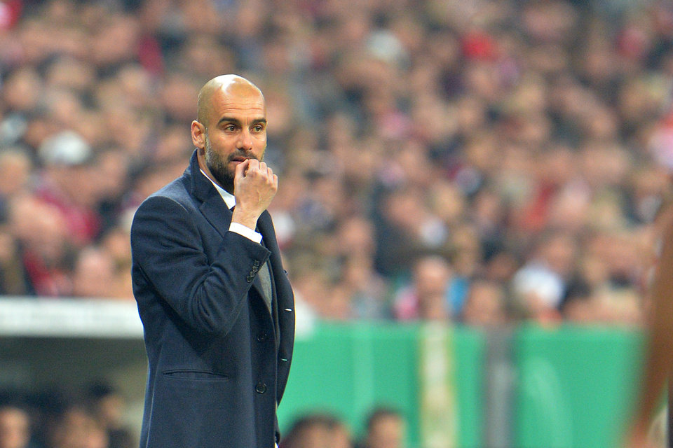 Photo - Munich head coach Pep Guardiola reacts during the German soccer cup, DFB Pokal, semifinal match between FC Bayern Munich and FC Kaiserslautern in the Allianz Arena in Munich, Germany, on Wednesday, April 16. 2014. (AP Photo/Kerstin Joensson)