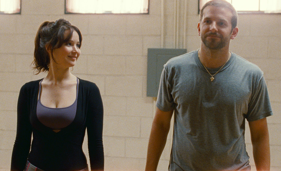 "FILE -This film image released by The Weinstein Company shows Jennifer Lawrence, left, and Bradley Cooper in ""Silver Linings Playbook."" The Weinstein Company's film is earning boffo business above $100 million in ticket sales following co-chairman Harvey Weinstein's familiar script of making the most of awards season. The 85th Academy Awards air live on Sunday, Feb. 24, 2013, on ABC. (AP Photo/The Weinstein Company, JoJo Whilden, File)"