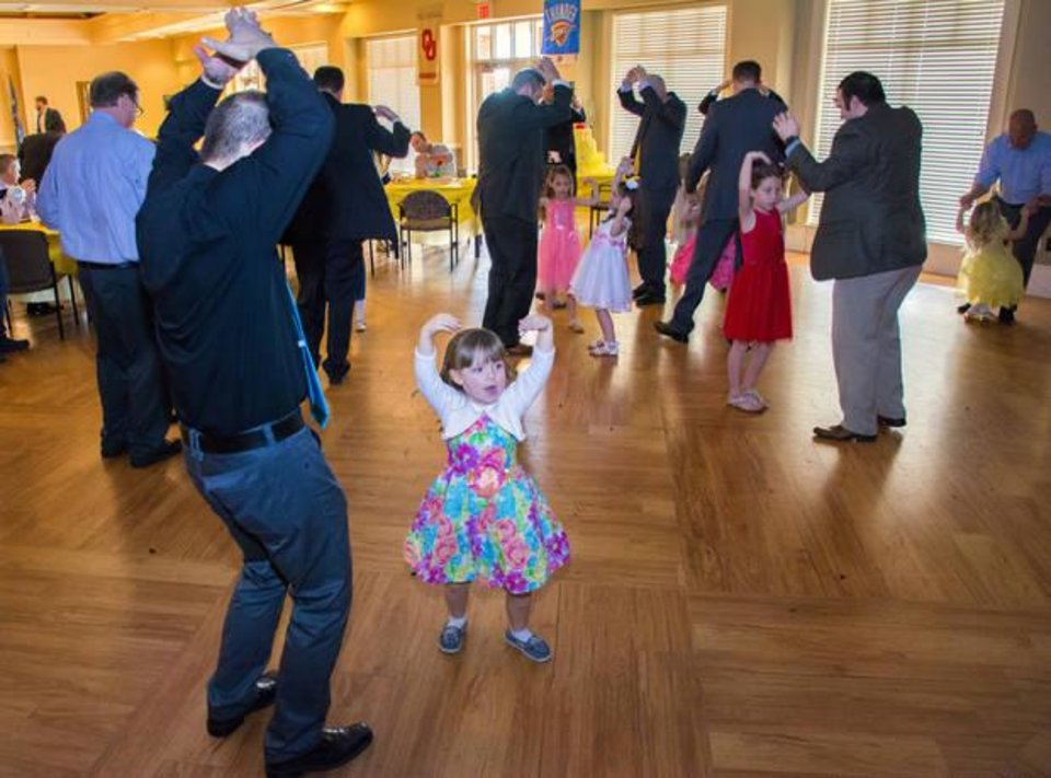 Photo -  Matt and Hailey Fields, 4, take to the dance floor at the Daddy-Daughter Dance. [PHOTO BY ERIECH TAPIA, FOR THE OKLAHOMAN]