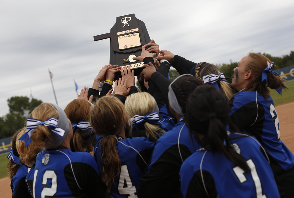 Photo - Little Axe players hold up their trophy after winning the 3A OSSAA Championship softball game between against Sequoyah at ASA Hall of Fame Stadium in Oklahoma City, Saturday, Oct. 6, 2012.  Photo by Garett Fisbeck, The Oklahoman