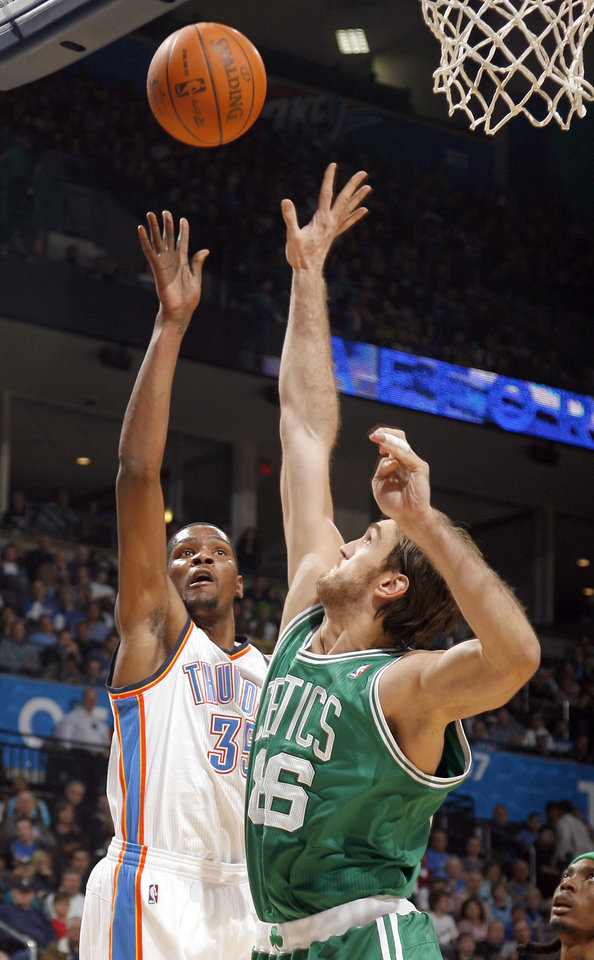 Photo - Oklahoma City's Kevin Durant (35) shoots over Boston's Semih Erden (86)during the NBA game between the Oklahoma City Thunder and the Boston Celtics, Sunday, Nov. 7, 2010, at the Oklahoma City Arena. Photo by Sarah Phipps, The Oklahoman