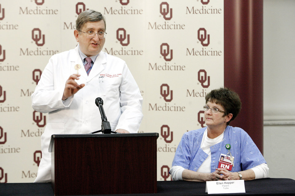 Photo - Dr. William Dooley of the OU Cancer Institute talks about clinical trials of a microwave heat treatment to shrink breast cancer tumors. With him is cancer survivor and trial participant Ellen Hopper. By Paul B. Southerland