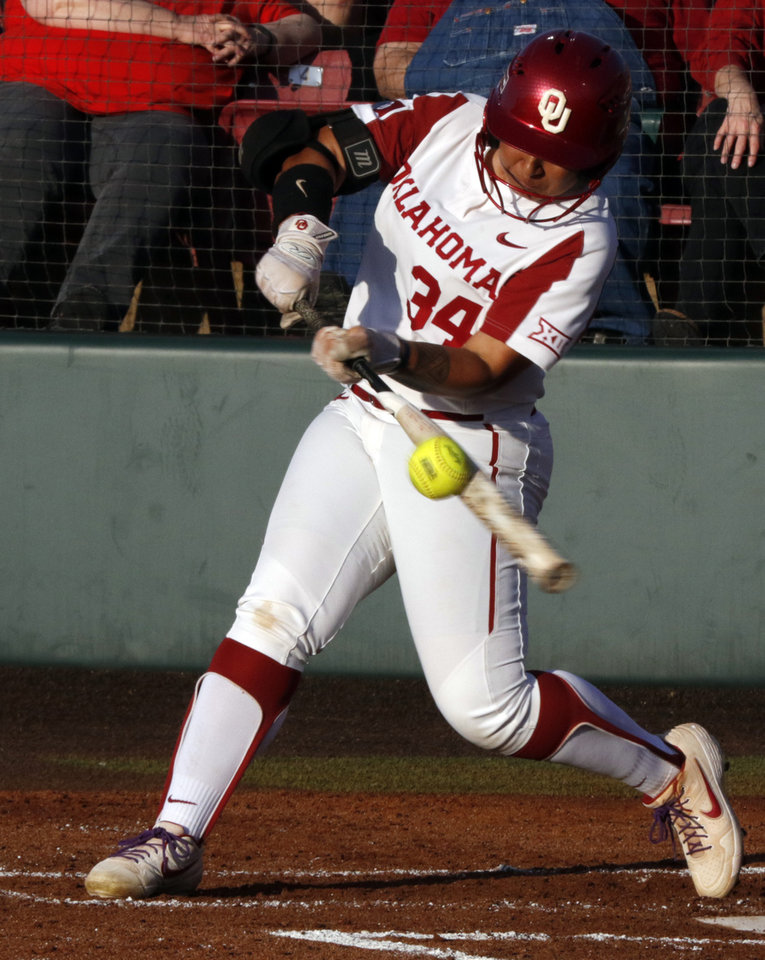 Photo - Falepolima Aviu hits in Bedlam softball as the University of Oklahoma Sooners (OU) play the Oklahoma State Cowboys (OSU) at Marita Hynes Field at the OU Softball Complex on  May 4, 2019 in Norman, Okla.  [Steve Sisney/For The Oklahoman]