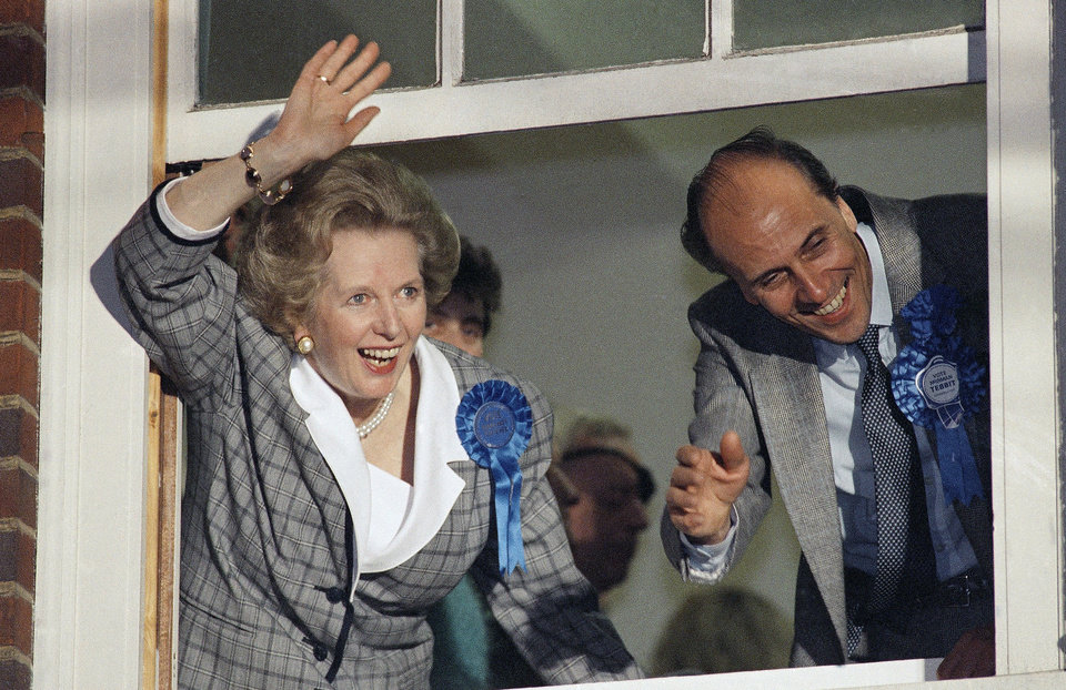 Photo - FILE - In this June 12, 1987 file photo, British Prime Minister Margaret Thatcher waves to supporters from Conservative Party headquarters in London after claiming victory in Britain's general election. Ex-spokesman Tim Bell says that Thatcher has died. She was 87. Bell said the woman known to friends and foes as