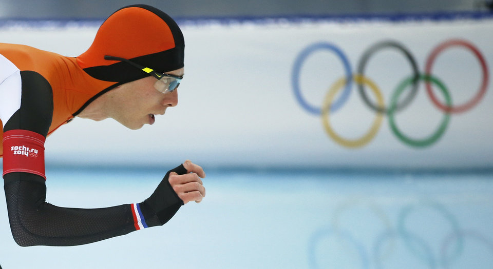 Photo - Gold medallist Jorrit Bergsma of the Netherlands competes in the men's 10,000-meter speedskating race at the Adler Arena Skating Center during the 2014 Winter Olympics in Sochi, Russia, Tuesday, Feb. 18, 2014. (AP Photo/Pavel Golovkin)