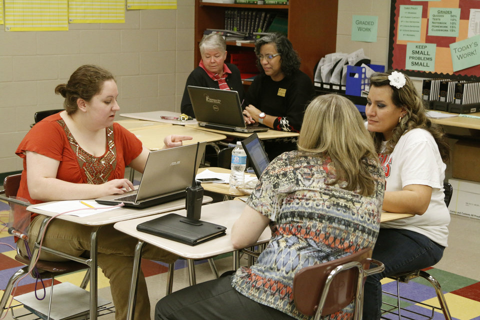 Photo - High school math teachers and administrators work together in professional learning communities at U.S. Grant High School in Oklahoma City on Monday.  PAUL HELLSTERN - The Oklahoman