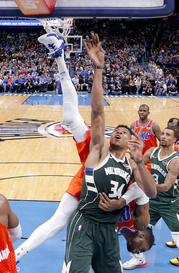 Photo - Oklahoma City's Nerlens Noel (9) gets tangled up with Milwaukee's Giannis Antetokounmpo (34) during the NBA game between the Oklahoma City Thunder and the Milwaukee Bucks at Chesapeake Energy Arena,   Sunday, Nov. 10, 2019.  [Sarah Phipps/The Oklahoman]