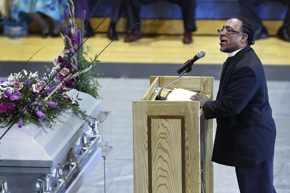 One of several ministers who spoke at the funeral, talks about Carter. About 400 family and friends gathered inside the Millwood High School Fieldhouse on Tuesday, Sep, 25, 2012, to honor the life and say farewell to Joseph D. Carter, Sr. at a funeral service that was sentimental and touching, but also full of joy and laughter. Carter is survived by a wife and their 11 children as well as 46 grandchildren, 35 great-grandchildren and 10 great-great-grandchildren. Photo by Jim Beckel, The Oklahoman.