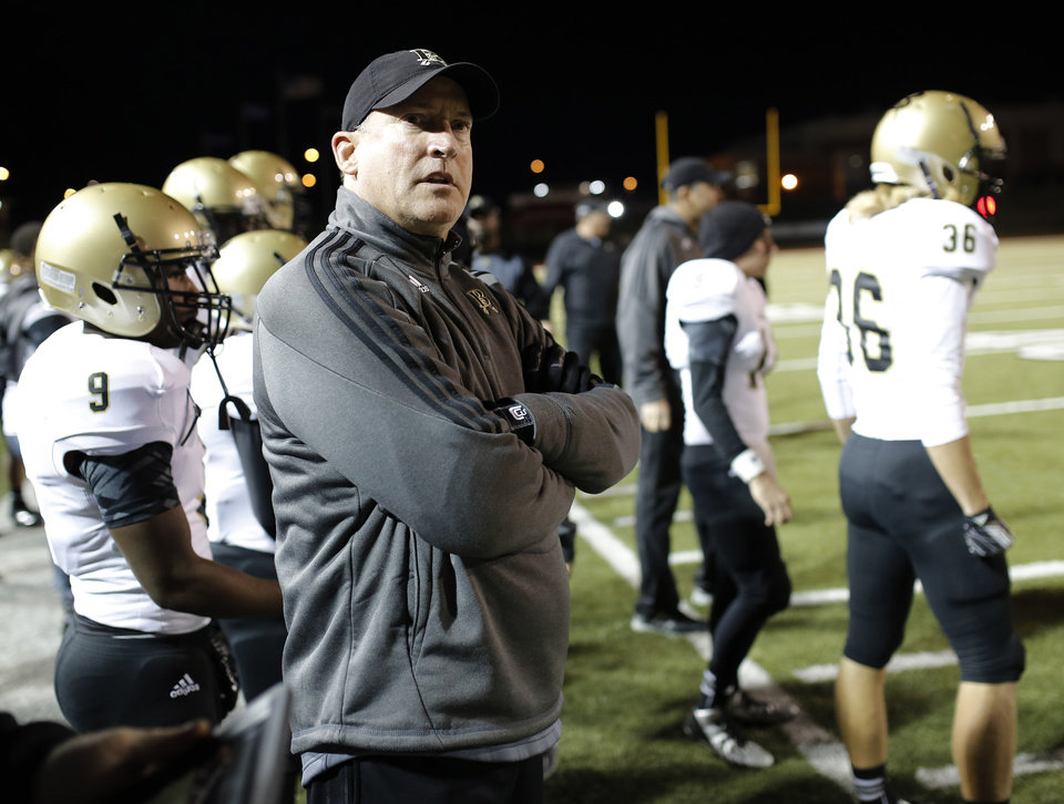 Photo - BA coach Steve Spavital watches looks at the scoreboard during the high school football game between Broken Arrow and Westmoore at Moore stadium Friday , November 8, 2013. Photo by Doug Hoke, The Oklahoman