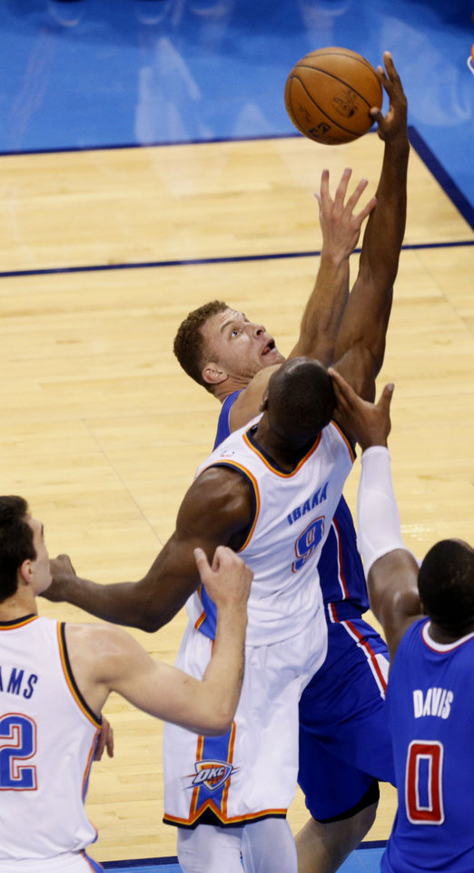 Photo - Blake Griffin (32) and Serge Ibaka (9) battle for a rebound during Game 5 of the Western Conference semifinals in the NBA playoffs between the Oklahoma City Thunder and the Los Angeles Clippers at Chesapeake Energy Arena in Oklahoma City,  Tuesday, May 13, 2014. Photo by Bryan Terry, The Oklahoman
