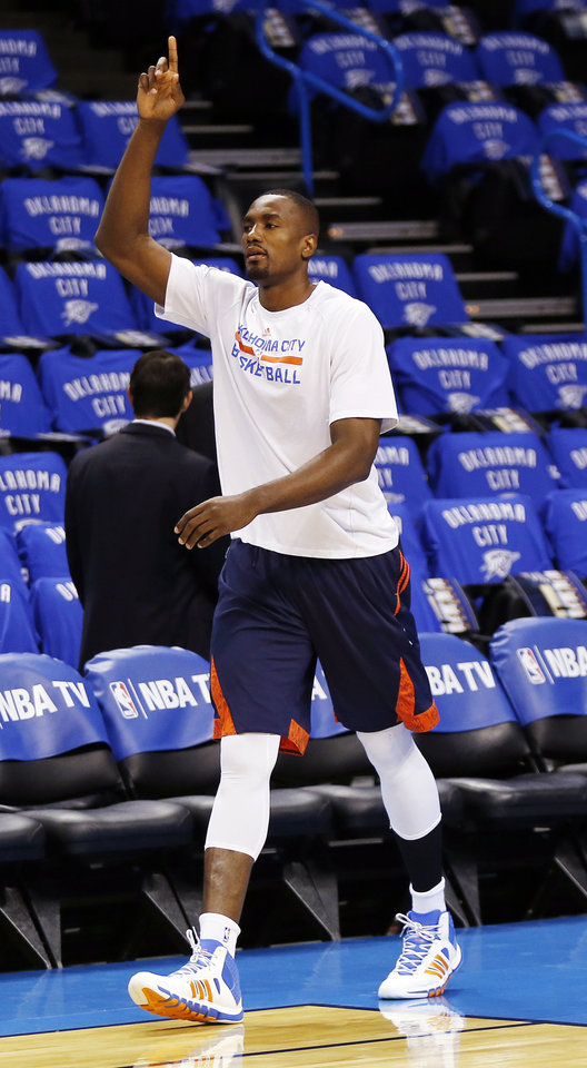 Photo - Oklahoma City's Serge Ibaka (9) walks on the court to warm up before Game 3 of the Western Conference Finals in the NBA playoffs between the Oklahoma City Thunder and the San Antonio Spurs at Chesapeake Energy Arena in Oklahoma City, Sunday, May 25, 2014. Photo by Nate Billings, The Oklahoman