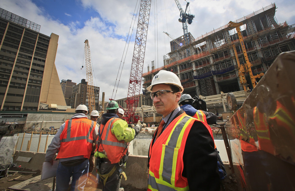 Photo - Michael Samuelian, right, Hudson Yards project director for planning and architecture, tours the project site site, Thursday April 17, 2014 in New York. The $15 billion Hudson Yards will fill 28 acres between the Hudson River and Tenth Avenue with six skyscrapers. (AP Photo/Bebeto Matthews)