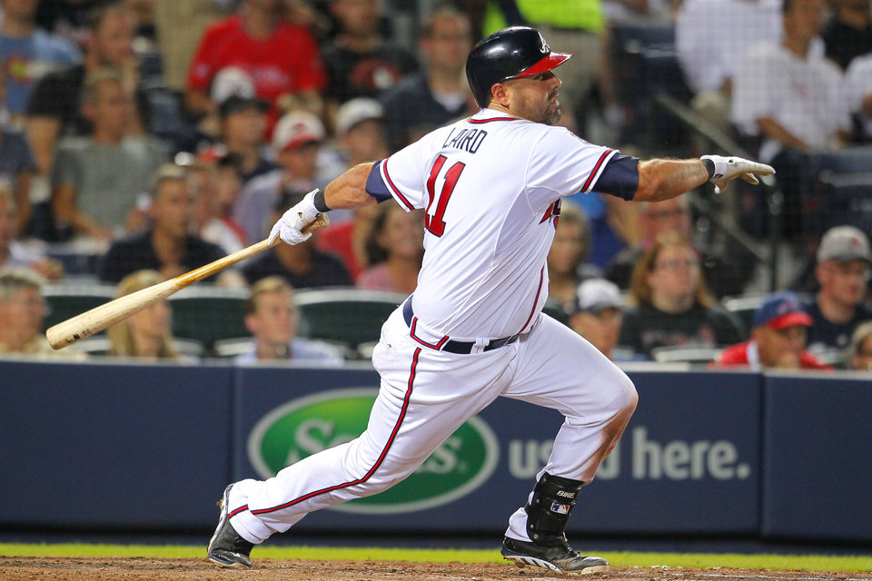 Photo - Atlanta Braves Gerald Laird  hits into a double play which scored Chris Johnson in the seventh inning of a baseball game against the Philadelphia Phillies Tuesday, June 17, 2014, in Atlanta. (AP Photo/Todd Kirkland)