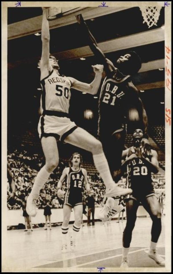 Photo -  Bethany Nazarene College basketball star Jeff Jantz, left, puts up a shot during a 1974 game against Oklahoma Baptist. Jantz set the school scoring record with 2,104 points, a mark that will likely be broken Thursday night by Jhonathan Dunn. [OKLAHOMAN ARCHIVES]