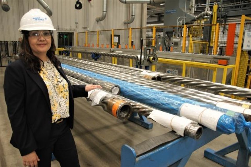 Photo -  Karen Lane, senior plant manager at the BHGE Motor Center of Excellence in Oklahoma City, shows downhole drilling motor rotors that are going through the manufacturing process at the center. [JACK MONEY/THE OKLAHOMAN]