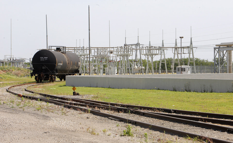 Photo -  A tank car for transporting seed oil on a siding at the Producers Cooperative Oil Mill property at SW 25 and Council Road. PHOTO BY PAUL B. SOUTHERLAND, THE OKLAHOMAN   PAUL B. SOUTHERLAND -