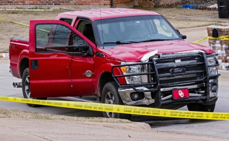Photo -  The truck, driven by alleged drunk driver Max Leroy Thompson, that hit six Moore High School students killing three sits in the road after the crash on Feb. 3. [Chris Landsberger/The Oklahoman]