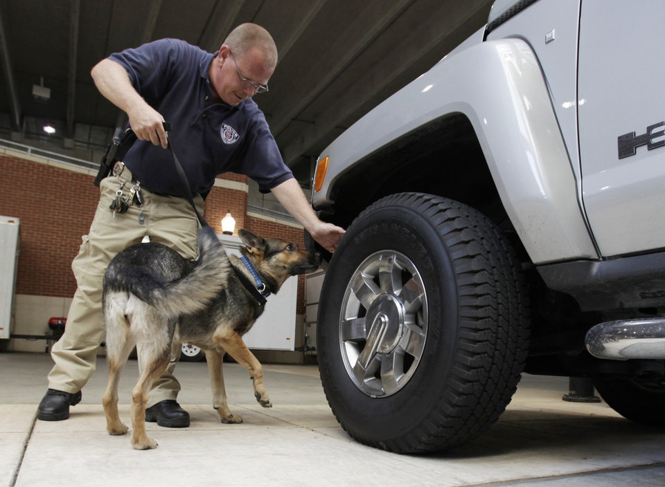 University of Oklahoma police officer and dog handler Brian Nelson works bomb-sniffing dog, Ambra,  at the University of Oklahoma on Thursday Sept. 2, 2010, in Norman, Okla.  Photo by Steve Sisney, The Oklahoman