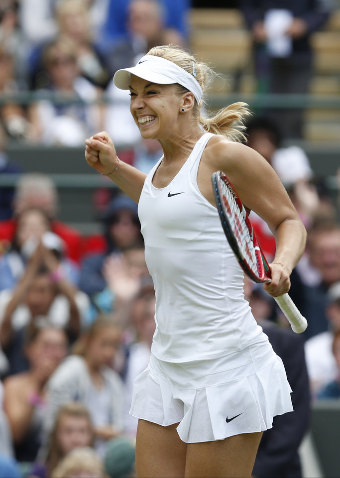 Photo - Sabine Lisicki of Germany celebrates defeating Ana Ivanovic of Serbia after their women's singles match at the All England Lawn Tennis Championships in Wimbledon, London, Monday, June 30, 2014. (AP Photo/Ben Curtis)