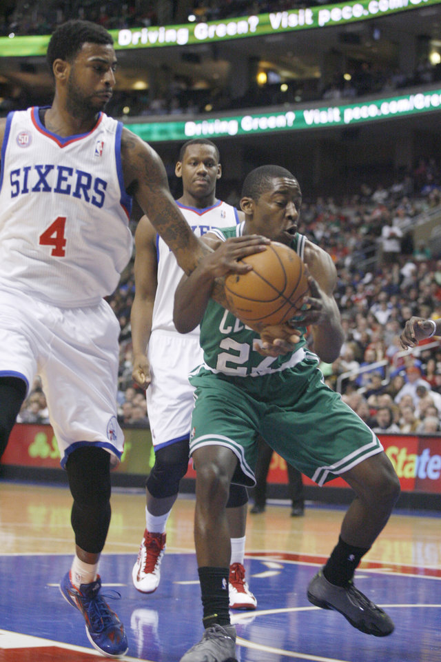 Boston Celtics' Jordan Crawford (27) and Philadelphia 76ers' Dorell Wright (4) fight for a rebound in the first half of an NBA basketball game, Tuesday, March 5, 2013, in Philadelphia. (AP Photo/H. Rumph Jr)