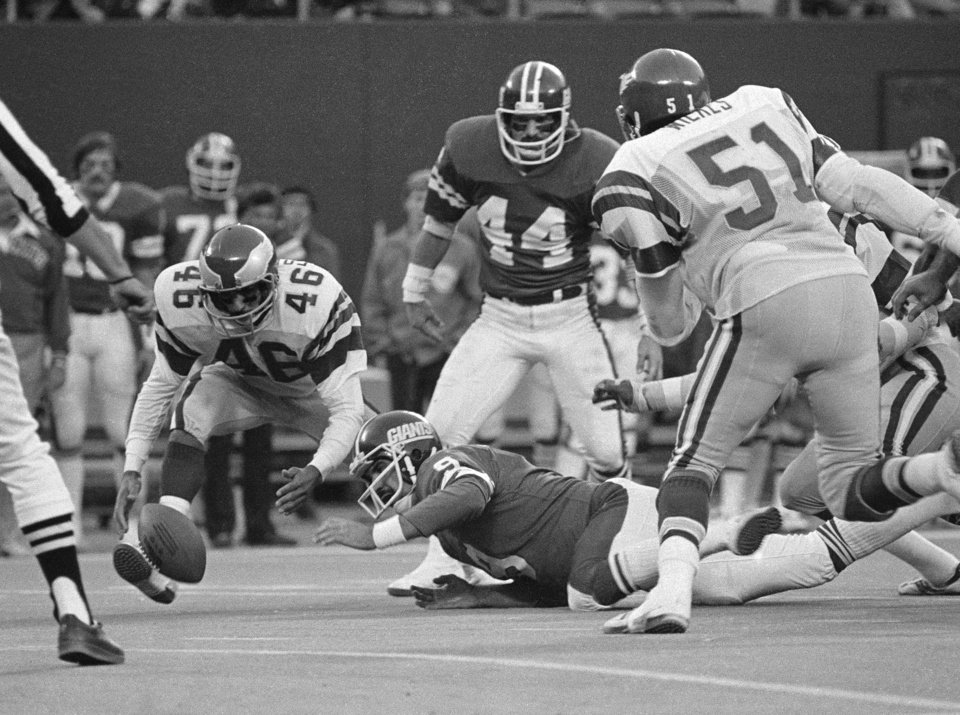 Photo - FILE - In this Nov. 19, 1978, file photo, Philadelphia Eagles' Herman Edwards pounces on the ball just fumbled by New York Giants quarterback Joe Pisarcik late in an NFL football game in East Rutherford. Edwards went in for the score and the Eagles won 19-17. The Eagles have enjoyed some of their greatest moments on the road against the Giants. Chip Kelly, the Eagles' coach, certainly doesn't need a refresher course before Sunday's game between the two struggling teams. He knows Philadelphia (1-3) and New York (0-4) go back a long way. (AP Photo/G. Paul Burnett, File)