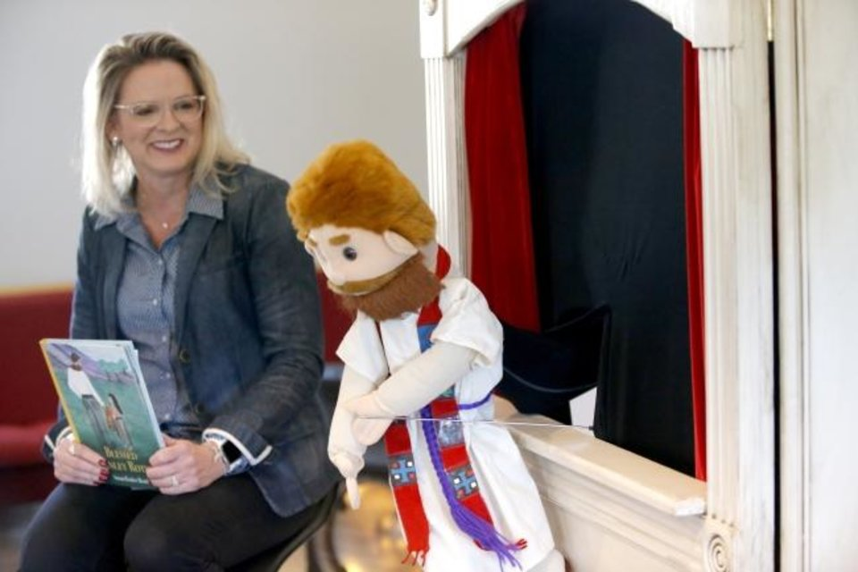 Photo - Susan Rother Bond talks about her book, Blessed Stanley Rother, as her husband, James Bond, performs a puppet show at the at the Gospel of Life Dwelling (GOLD) Stanley Rother Barn in Moore, Okla.,  Saturday, Jan. 4, 2020.  [Sarah Phipps/The Oklahoman]