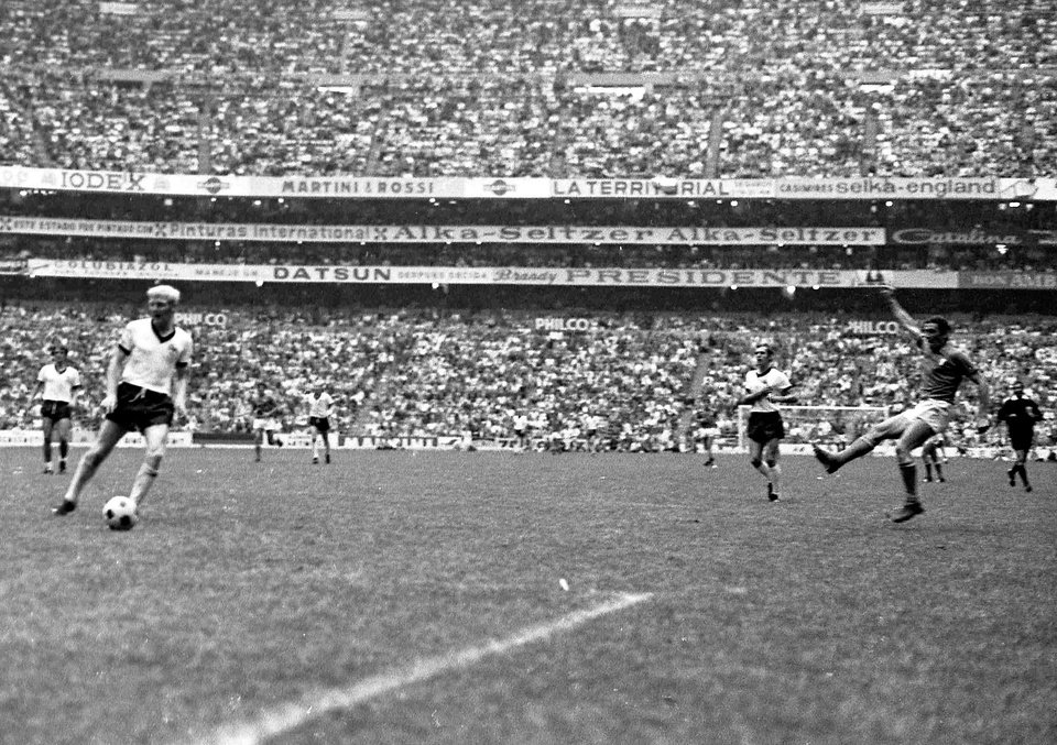 "Photo - FILE - In this June 17, 1970 file photo, Italy's Luigi Riva, right, scores the third goal for Italy in the World Cup semi-final soccer match between Italy and West Germany, in Mexico City, Mexico. On this day: Italy defeated West Germany 4-3 in a match often referred to as ""The Game of the Century.""  (AP Photo/Gianni Foggia, File)"
