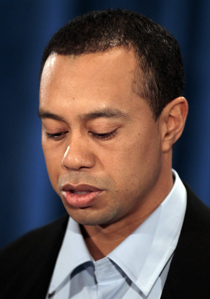 Photo - Tiger Woods makes a statement at the Sawgrass Players Club, Friday, Feb. 19, 2010, in Ponte Vedra Beach, Fla. (AP Photo/Joe Skipper, Pool) ORG XMIT: TWP105