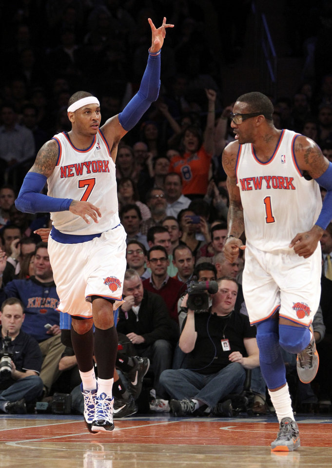 New York Knicks' Carmelo Anthony (7) and Amar'e Stoudemire react after Anthony scored a basket during the second half of NBA basketball game against the Orlando Magic, Wednesday, Jan. 30, 2013, at Madison Square Garden in New York.  The Knicks won 113-97.(AP Photo/Mary Altaffer)