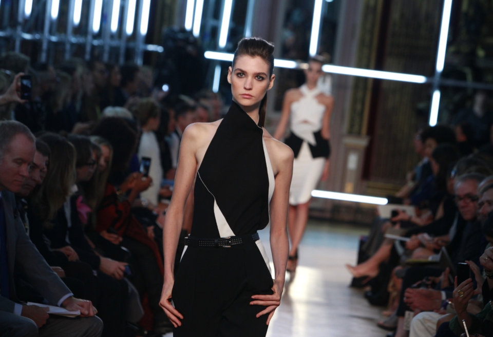 Photo -   A model wears a creation for French fashion designer Roland Mouret's Spring-Summer 2013 ready to wear collection, presented in Paris, Friday, Sept.28, 2012. (AP Photo/Thibault Camus)