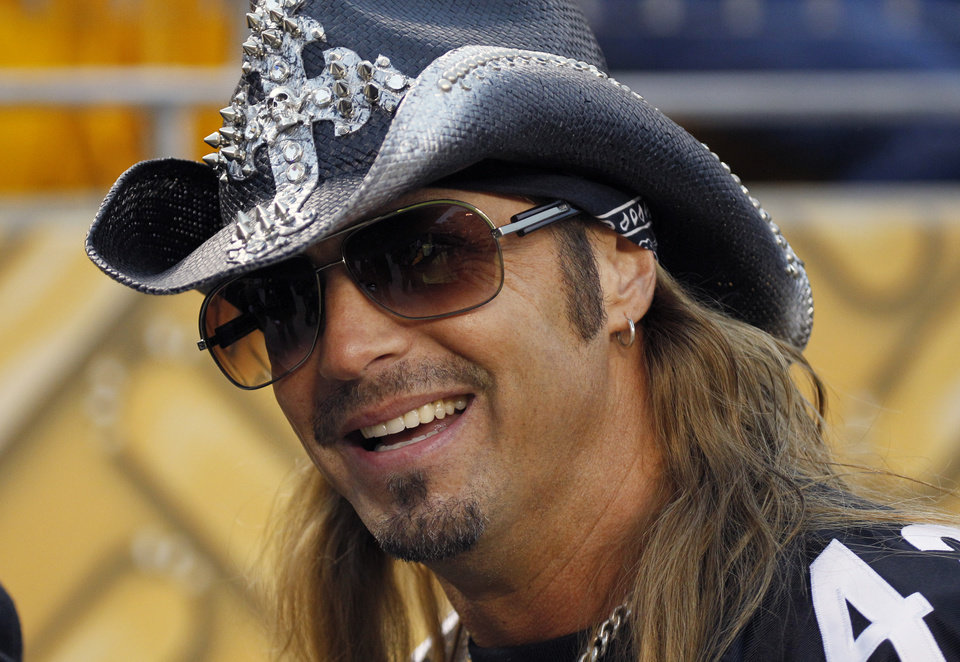 FILE - In this Saturday, Jan. 15, 2011 file photo, Rock and Roll artist Brett Michaels warms up before an NFL divisional playoff football game between the Pittsburgh Steelers and Baltimore Ravens in Pittsburgh. Michaels' attorney announced Monday May 14, 2012 that the rocker had reached a confidential settlement in his lawsuit against the Tony Awards that claimed a set mishap nearly cost him his life in 2009. He was hit in the head by a set piece during the awards show and for months contended with brain bleeding and other effects of the injury. (AP Photo/Gene J. Puskar, File)