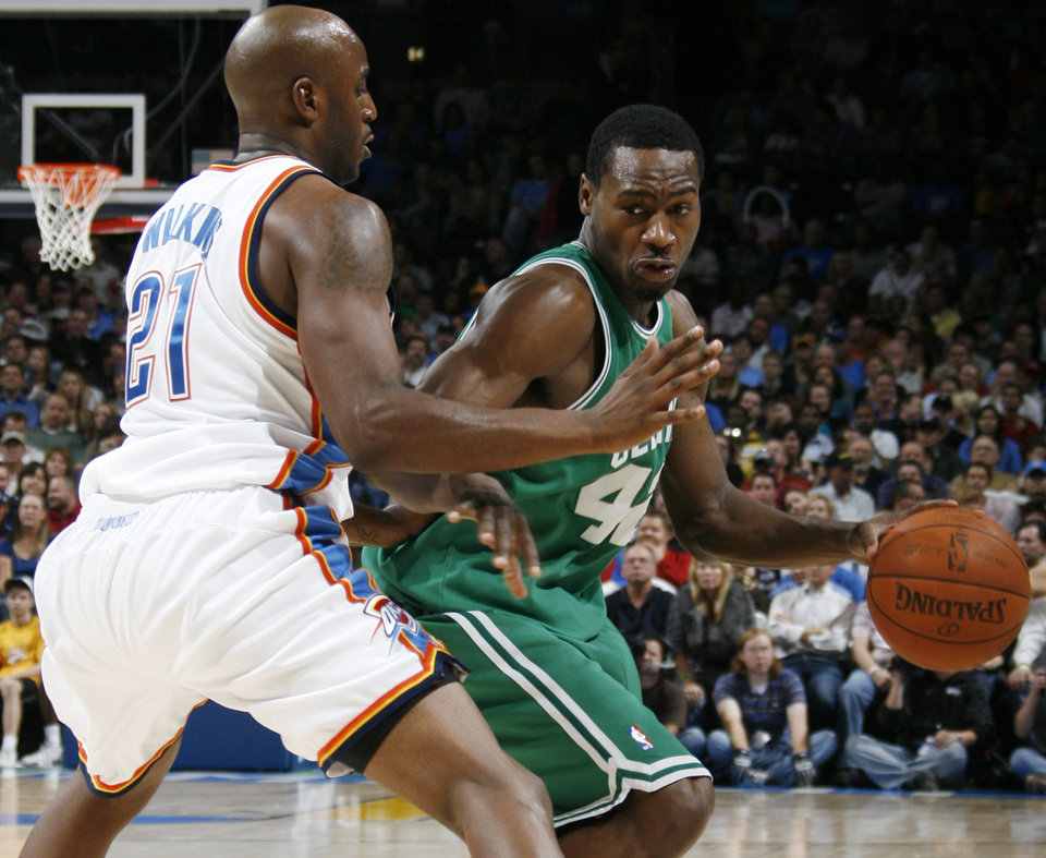 Photo - Boston's Tony Allen tries to get the ball around Damien Wilkins of the Thunder in the second half during the NBA basketball game between the Oklahoma City Thunder and the Boston Celtics at the Ford Center in Oklahoma City, Wednesday, Nov. 5, 2008. Boston won, 96-83. BY NATE BILLINGS, THE OKLAHOMAN