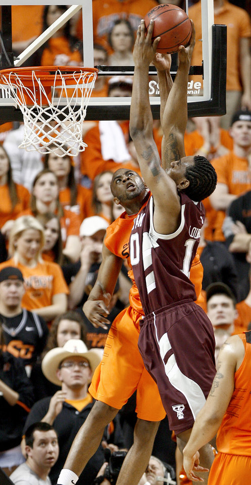 Photo - OSU's James Anderson defends Texas A&M's Daivd Loubeau during an NCAA college basketball game between the Oklahoma State University and Texas A&M at Gallagher-Iba Arena in Stillwater, Okla., Wednesday, January 27, 2010. Photo by Bryan Terry, The Oklahoman