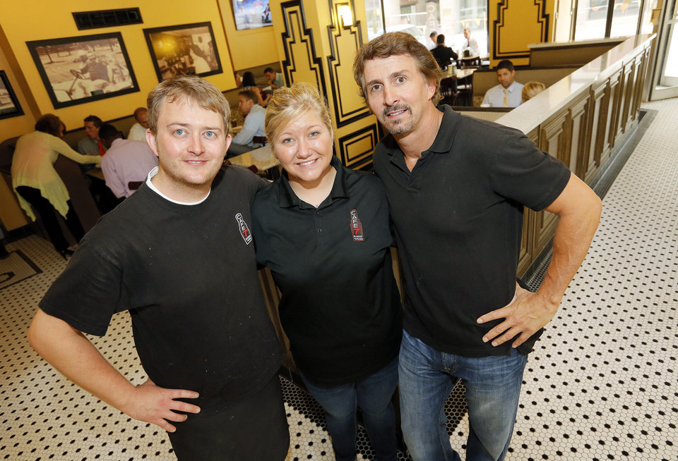 Photo - Cafe 7 owners Jimmy Mays, left, Stephanie Morrical and Paul Sorrentino are shown.