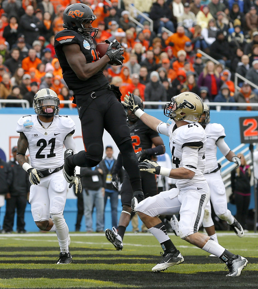 Oklahoma State's Blake Jackson (18) catches a touchdown pass between Purdue's Ricardo Allen (21) and Landon Feichter (44) during the Heart of Dallas Bowl football game between Oklahoma State University and Purdue University at the Cotton Bowl in Dallas, Tuesday, Jan. 1, 2013. Photo by Bryan Terry, The Oklahoman